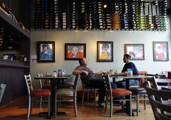 True Colors Collection hanging on the walls at Tastes Wine Bar and Bistro