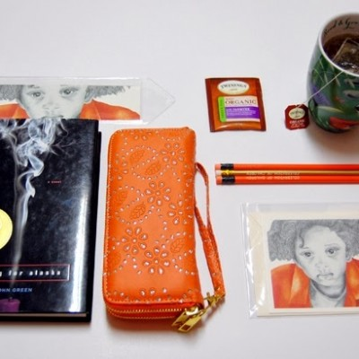 TCC April 2014 Gift Guide including Orange Boy 1, John green book, charming charlie purse, color pencils
