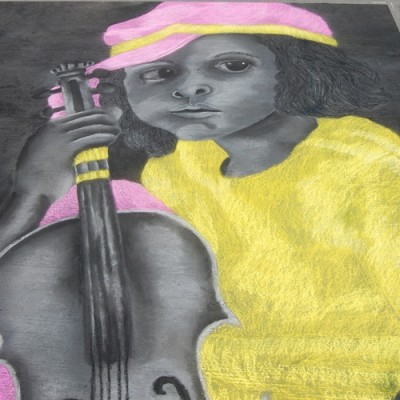 Chalk drawing of little girl with a violin in pink and yellow