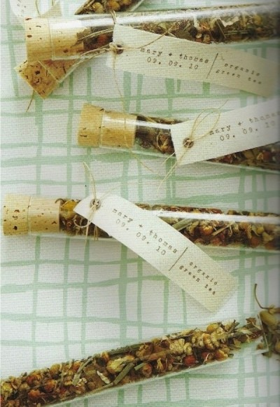 Tubes of tea leaves for Save The Date wedding