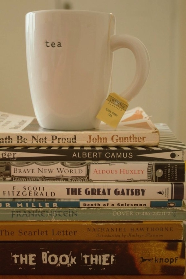 Cup of tea on top of a stack of books