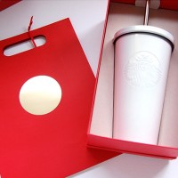 Starbucks Holiday Red Gift Bag with gold seal and white tumbler in a red box