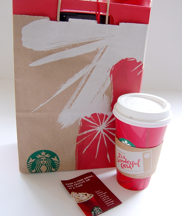 Starbucks brown bag and Red Holiday Cup and points booklet
